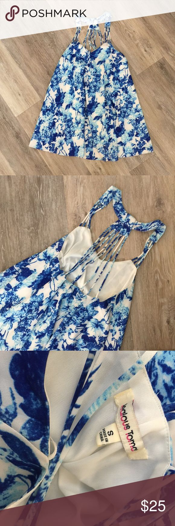 Blue + White Strappy Dress Like New blue and white dress with strapping detailing on the back. Very flowy. Would be perfect for a beach vacay :) size small. No trades. Poshmark transactions only :) Dresses