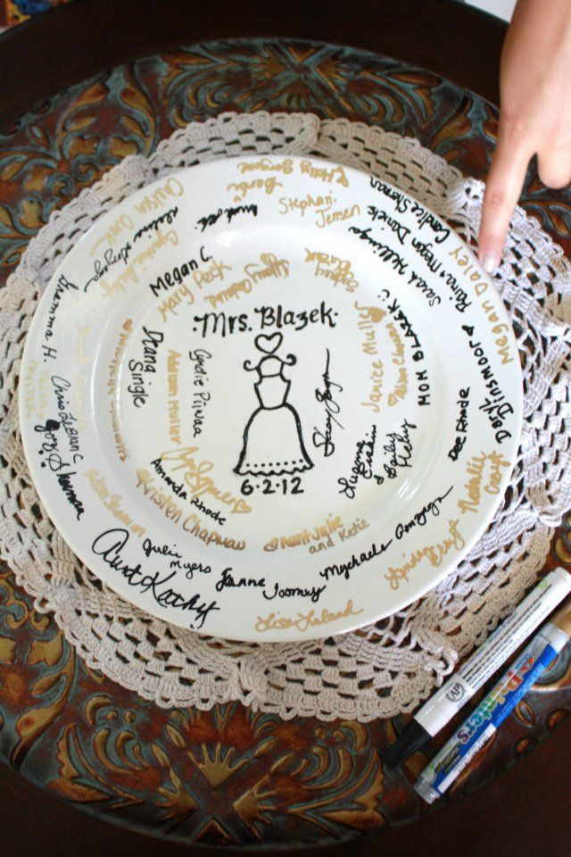 "Bridal shower ""Guest Book.""  Everyone signs a special plate for the bride  :)"