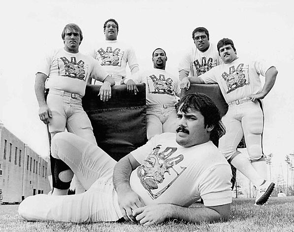 """The Hogs - Redskins George Starke, Russ Grimm, Jeff Bostic, Mark May, Joe Jacoby, Don Warren, Rick """"Doc"""" Walker,John Riggins ( not shown) ,Joe Bugel"""