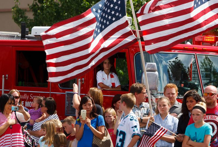 (Trent Nelson     The Salt Lake Tribune)  Flags fly as the funeral procession for Sgt. Derek Johnson, the Draper police officer who was shot to death on Sunday morning, passes through Draper Friday, September 6, 2013.
