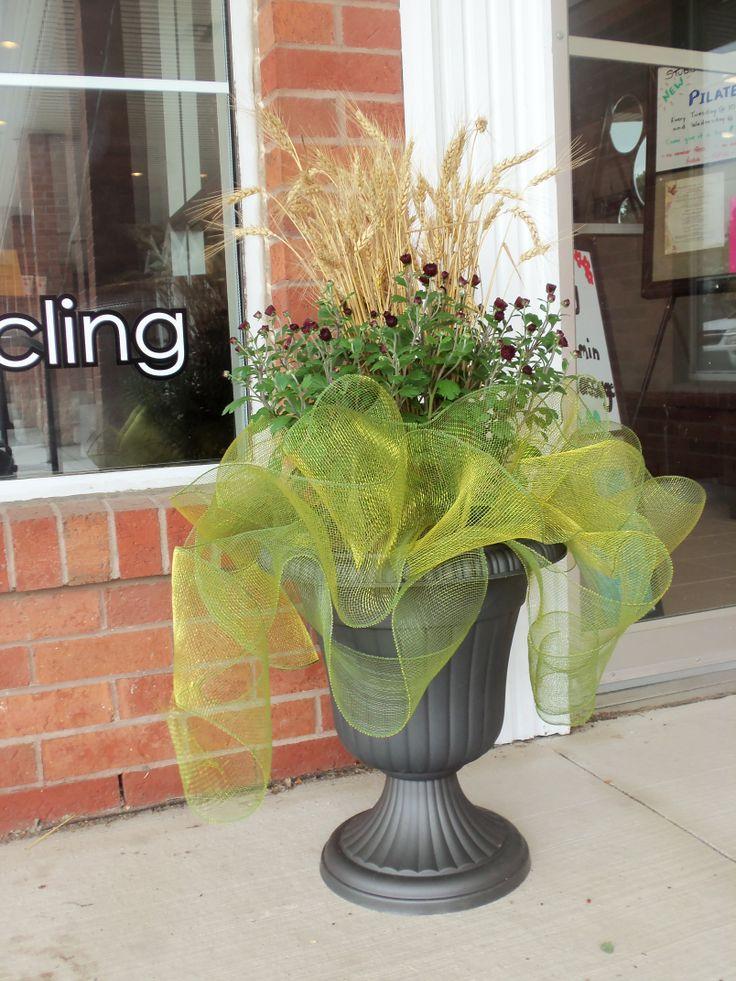 Fall mums, wheat, and sinnamay ribbon make this autumn arrangement stunning.