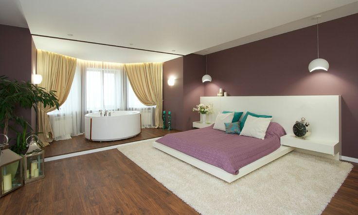 http://boomzer.com/glamorous-bed-space-perfect-for-recline-all-day/lilac-bedroom-wooden-floor-white-rug-shag-green-plants-indoor-wall-lamp-ceiling-light-shade-cream-curtains-glass-windows-white-bathtup-white-flower-in-white-vase-rosy-bedcover-teal-pillows-lovely-lila/