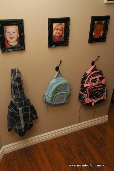 Entry Way Coat Rack with Pictures Hanging Above - Love it.