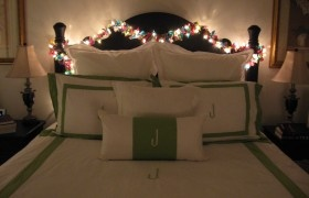 Fabric scraps and christmas lights make up a garland. The placement is my favorite. And it's a big 'grown-up' bed. Like the matching end tables and lamps.