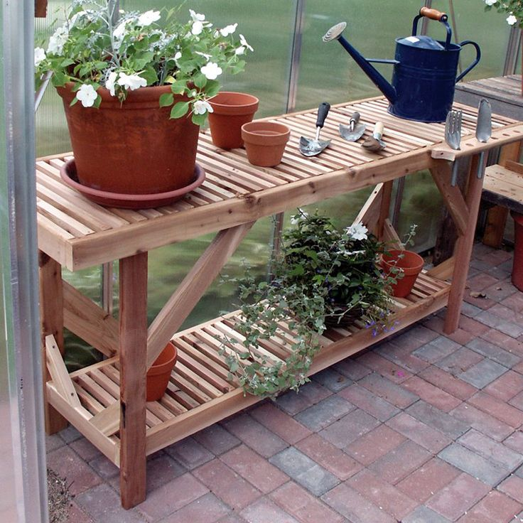Best 25 greenhouse benches ideas on pinterest for Inexpensive greenhouse shelving wood