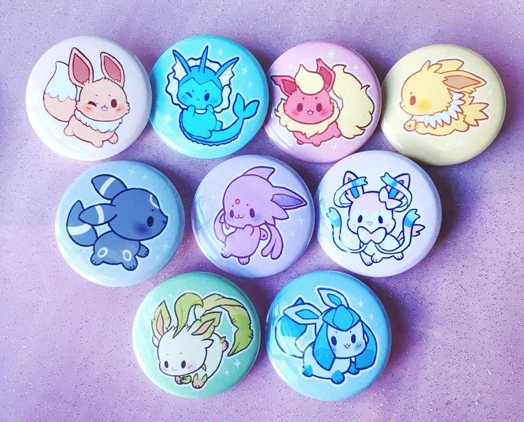 """Eeveelutions 1.5"""" Buttons. Definitely need to get my hands on these adorable little gems!"""