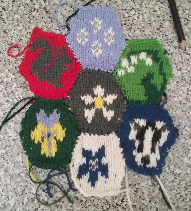 My first seven botanical hexagons joined and ready for backing. I need to get better at that invisible joining stitch.