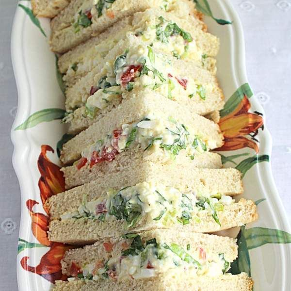 Irish salad sandwiches are sometimes called egg and onion sandwiches, or egg and tomato sandwiches. These triangular sandwiches may or may not include lettuce.