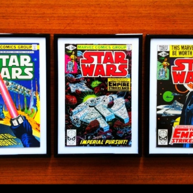 Vintage Star Wars comics from 1980 as art in a kids room.