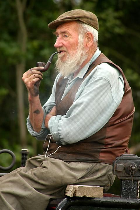 Old people have a fashion all their own, a fashion greatly accentuated by a white beard and a brown pipe.