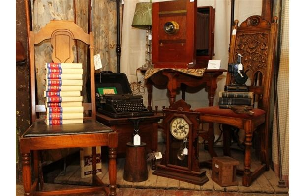 A grouping that includes a large camera, old typewriter and a mantle clock for sale at Sentimental Journey Antiques in Nanton.