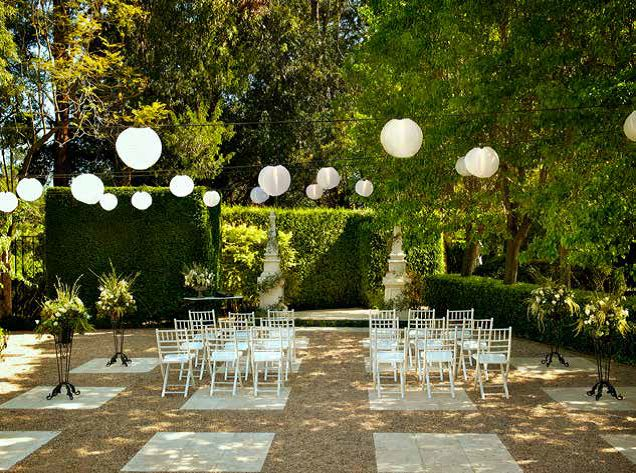 A magical ceremony set-up, with lovely planter urns framing the ceremony chairs.