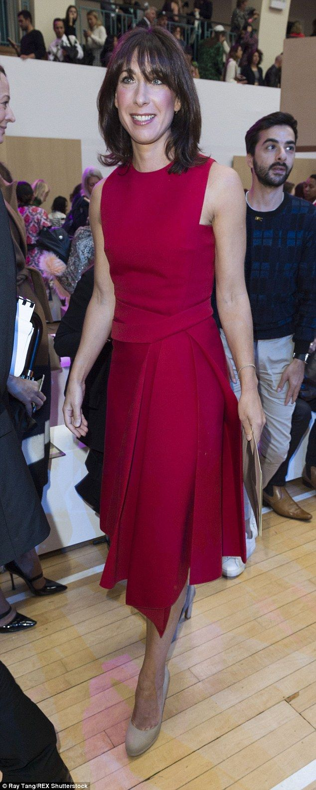 Samantha Cameron looked ravishing in red as she arrived to take her seat in the front row of Roksanda's spring/summer 16 show