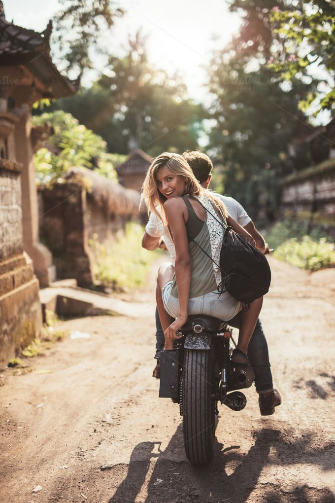 Young couple riding motorcycle by Jacob Lund Photography on @creativemarket
