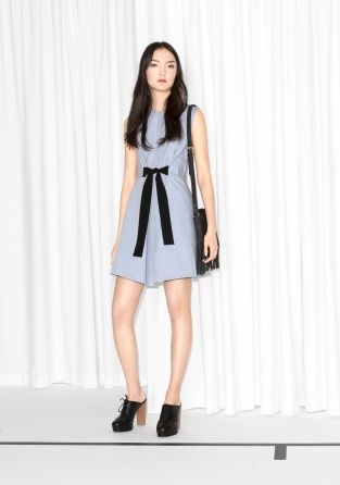 A charming and ultra flattering cotton dress featuring a sweet A-line silhouette with modern detailing for a more contemporary edge.