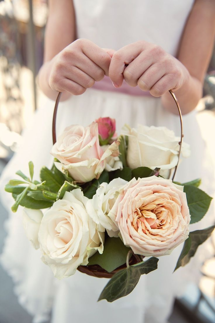If your flower girl can't throw petals down New Orleans, St. Louis Cathedral's aisle, just a beautiful basket of arranged flowers, using blush roses, ivory roses, and some mixed greenery still does the trick!