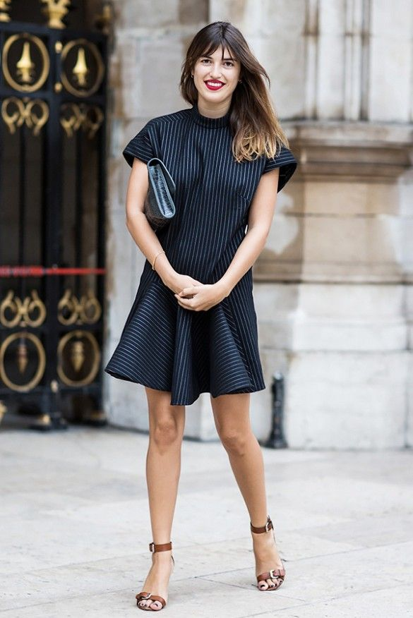 Jeanne Damas wears a black pinstripe dress with ankle-strap sandals and a clutch: