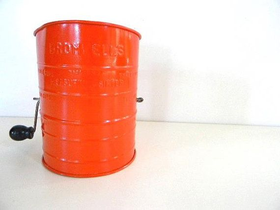 vintage red/orange bromwell flour sifter on Etsy, $14.00