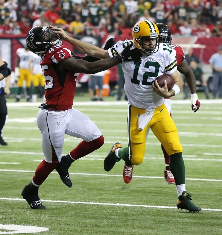 Packers vs. Falcons:    October 30, 2016  -  33-32, Falcons  -      October 30, 2016 ATLANTA: Packers Aaron Rodgers stiff arms Falcons defender Deion Jones who holds on to make the tackle on a quarterback keeper during the first half in an NFL football game on Sunday, Oct. 30, 2016, in Atlanta. Curtis Compton /ccompton@ajc.com