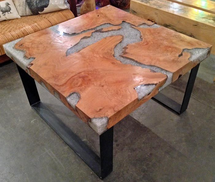 A coffee table made from reclaimed old growth teak tree Tree trunk coffee table glass top