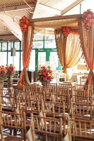 gold draped... almost too elaborate. would be fun to find a way to make the mandap look kind of italian? with olive branches or something?