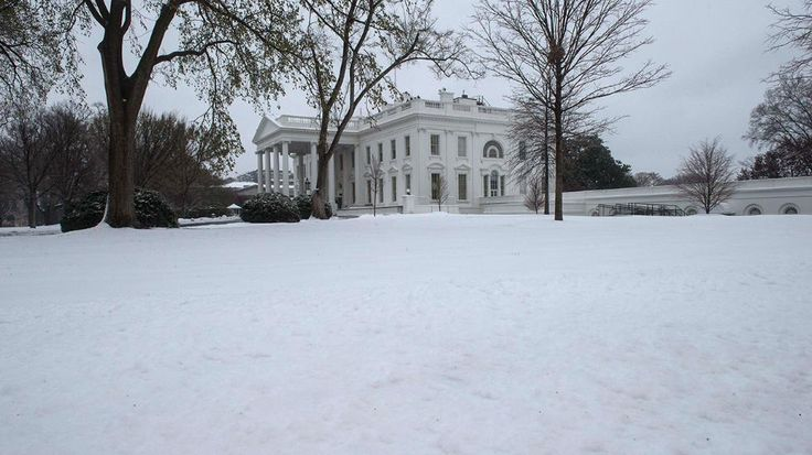 The White House is seen in Washington, DC, on March 14, 2017 following a snowstorm. Winter Storm Stella dumped snow and sleet Tuesday across the northeastern United States where thousands of flights were canceled and schools closed, but appeared less severe than initially forecast. (Nicholas Kamm/AFP/Getty Images)