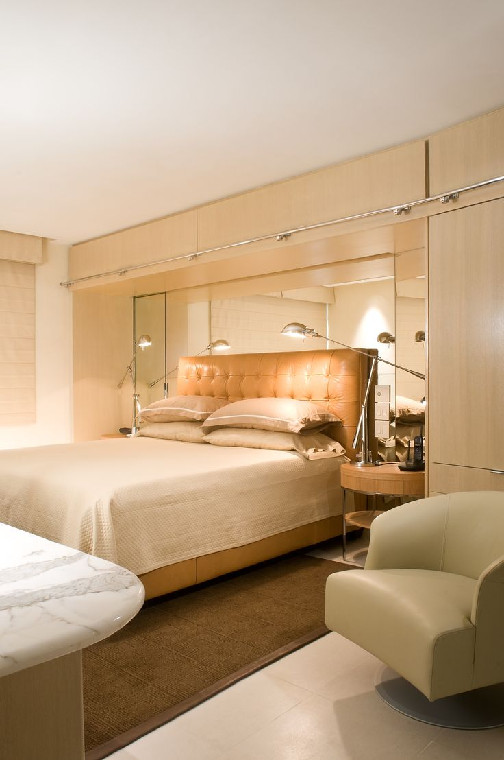 The Peninsula Penthouse Apartment Master Bedroom Mirrored Back Storage Above By Jerry Jacobs Design