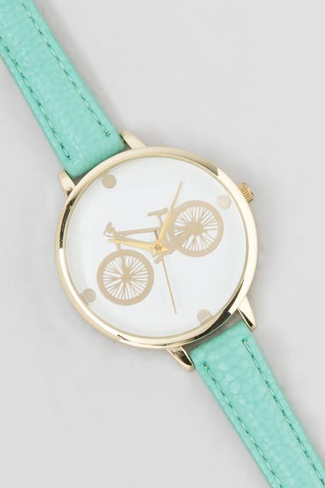 The cute Bicycle Watch is a darling novelty accessory! The gold faced watch features a gold bicycle print with gold dots at each quarter hour. The gold combined with the skinny mint bands makes for a lovely springtime watch.