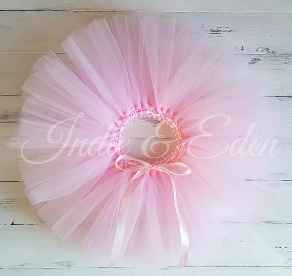 Handmade beautiful super full & fluffy short tutu in baby pink colour with fully adjustable waistband using ribbon tie. Available in many sizes & many colour ways! Made with 2 x layers of baby pink tulle. Please message us if youd like to discuss your specific requirements!