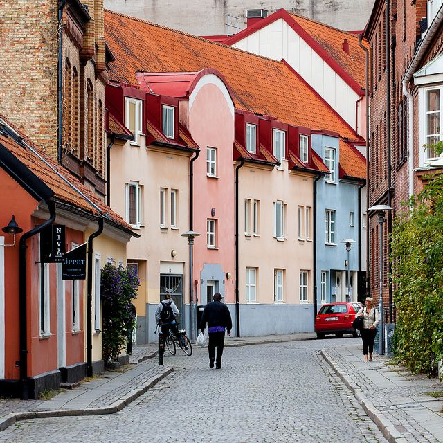 """Stora Fiskaregatan,"" by Rutger Blom, via Flickr -- Pastel beauties on a cobblestone street in Lund, Sweden"