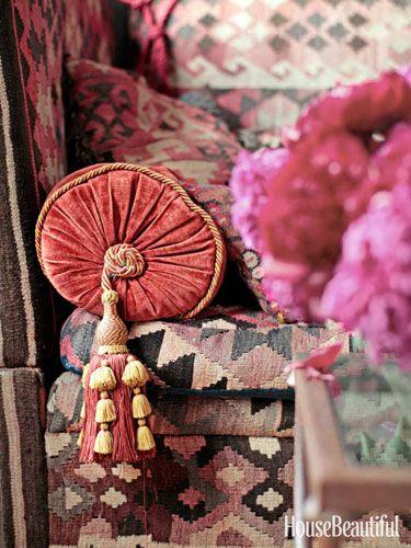 Venetian-style Houlès tassels embellish a library bolster on the sofa. Design: Alexander Doherty.