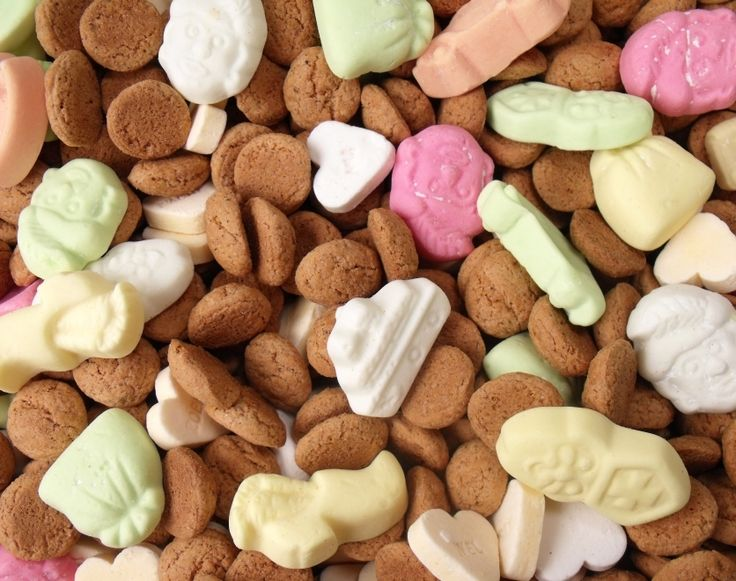 """""""Strooigoed"""" - Sinterklaas candy consisting of """"pepernoten"""" (mini gingerbread cookies), themed foam candy, conversation hearts and other sweets. It is thrown towards the children by Zwarte Pieten at the arrival of Sinterklaas."""
