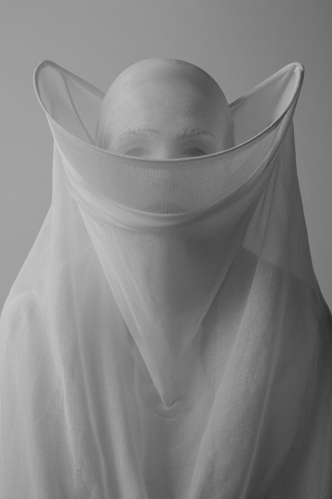 Los Angeles based photographer Nicholas Alan Cope, whose superb book, Whitewash, we featured last year, has again grabbed our attention with another superb photographic series, Vedas. A collaborative project with fellow photographer and designer Dustin Edward Arnold, Vedas — meaning knowledge in Sanskrit — marked their move into fashion imagery through photographing sculptural garments of their own design, and to challenge ideas of what is acceptable against what is possible.
