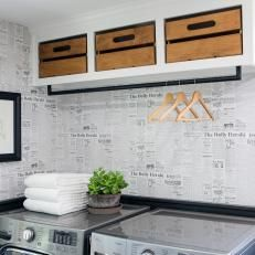 Renovated Laundry Room With Newspaper-Like Wallpaper