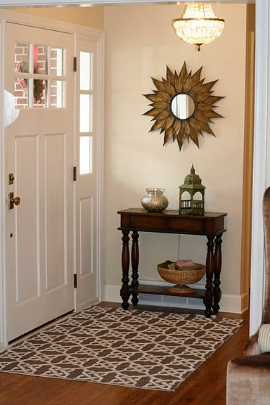small entry way I would love a statement piece-sunburst, clock display, or ornate mirror type things