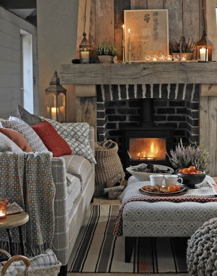 Looking for living room decorating ideas? Be inspired by this cosy fireplace with warming textures and linens