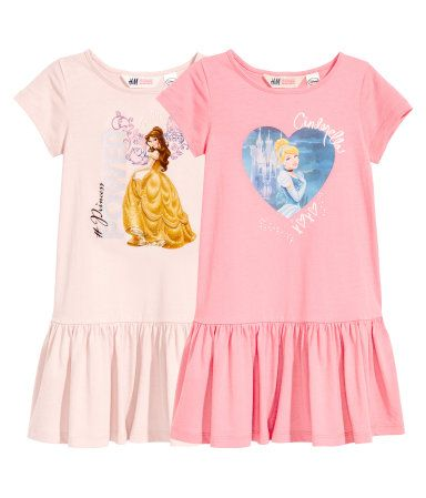 Pink/Disney Princesses. Short-sleeved, gently flared dresses in cotton jersey with a printed design. Seam at hips.