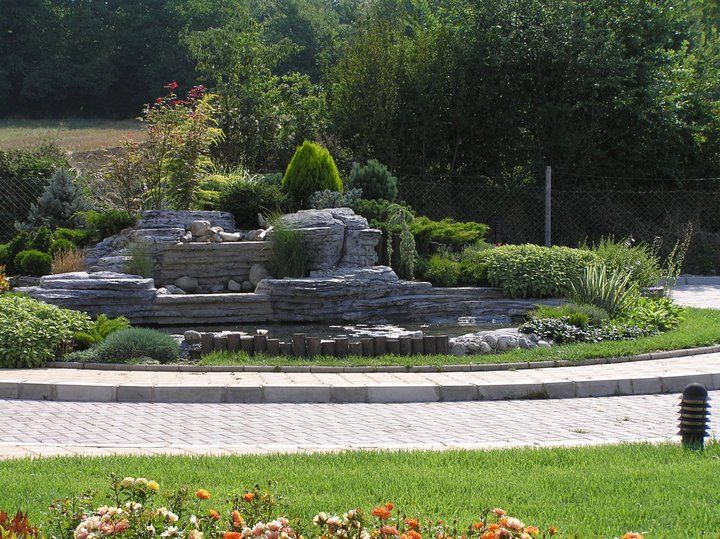 Garden With Artificial Rock Fountain Driveway Landscaping And Curb