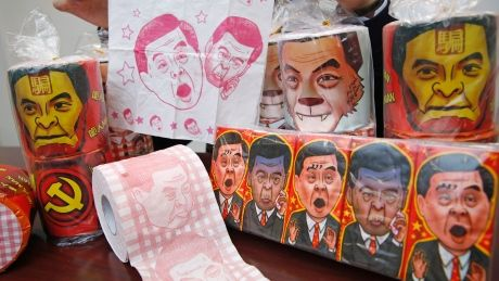 Rolls of toilet paper and packages of tissue paper printed with images of pro-Beijing Hong Kong Chief Executive Leung Chun-ying are shown by Hong Kong Democratic Party Vice Chairman Lo Kin-hei at his office in Hong  http://pronewsonline.com