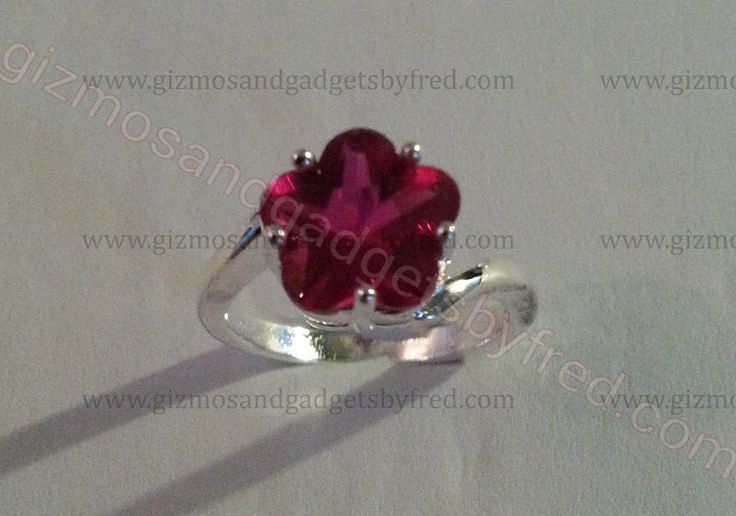 Great looking Flower shaped cubic zirconia in sterling silver. Great gift idea at a low price and most important top quality. Available at gizmosandgadgetsbyfred.com