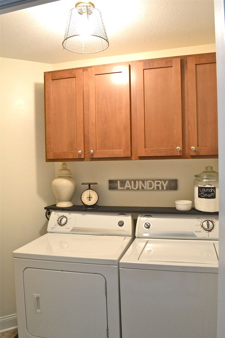 Like the idea of the shelf right above the washer dryer, especially since I can't reach the top shelves of the cabinet