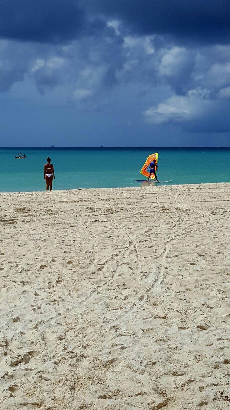 Enjoying the sun and sea at Eagle beach.