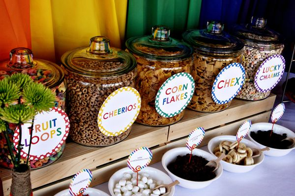 CUTE IDEA! Put cereal in large glass jars for a fun breakfast party while entertaining guests! Rainbow Breakfast Party via Kara's Party Ideas | Kara'sPartyIdeas.com #rainbow #breakfast #party (3)