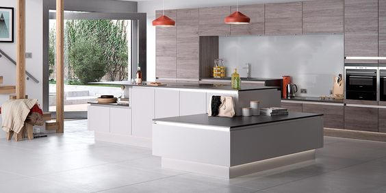 Modern Handleless Kitchen. Reno in Heritage Grey and Smoked Oak, with Masterclass you can get creative with your kitchen island using cabinets of different heights and open shelving