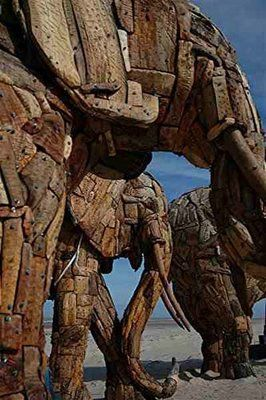 Close up of sculpture installation by Andries Botha consists of 9 life sized elephants constructed of thousands of little wooden pieces, bolted onto metal frameworks