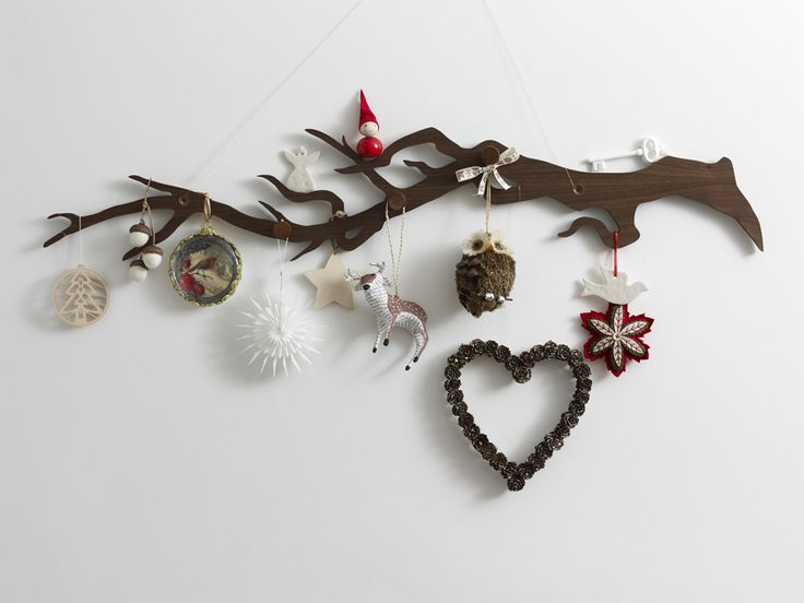 This would make a really really sweet advent calendar. Buy the rack here: http://www.skandivis.co.uk/decorate_homeware/clothes_hook/oksa-hook#.Ube-sPmUTxU