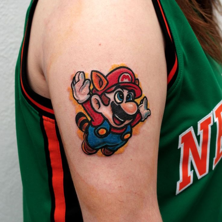 Super Mario World tattoo by Chris Morris. #supermario #videogame #ChrisMorris