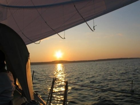Sailing at sunset off the coast of Cape Ann, Massachusetts