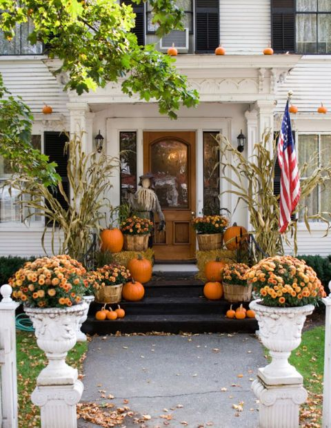 Think beyond the stoop and line the front walk with pumpkins, mums and stalks of corn. Don't forget up top either. Mini gourds on ledges put a seasonal spin on traditional window boxes. And whatever you do? Don't forget to keep it (mostly) symmetrical. Click through for more fall porch decorations.