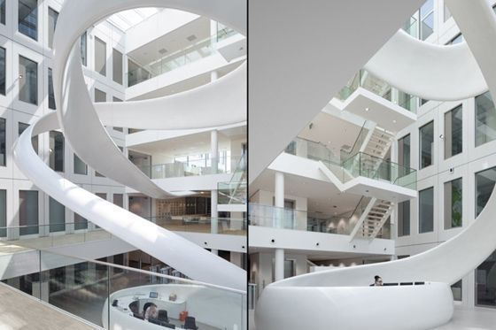 Designed by Fokkema & Partners the FrieslandCampina Innovation Centre incorporates brand identity in the atrium;  corporate environment; interior design; organic architecture; milksplash #organicarchitecture